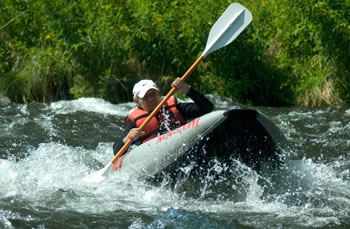Image of a man rafting.